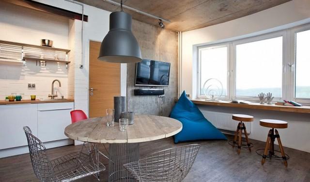 Studio draped in metal, wood and brick